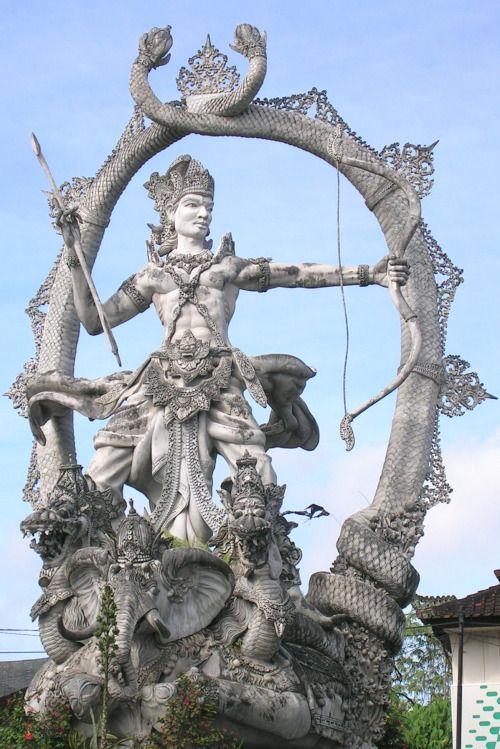 A statue of Arjuna on a street in Bali