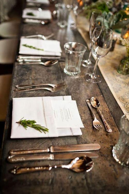 Napkin menu square with greens. Antique silverware.