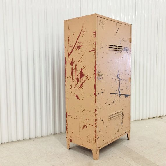 *AVAILABLE ON ETSY* Large vintage industrial storage cabinet, single vented door, four adjustable shelves, tapered legs, ca. 1950s. This is a heavy duty cabinet.
