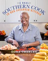"""24. A REAL SOUTHERN COOK: In Her Savannah Kitchen by Dora Charles    These are the intensely satisfying dishes at the heart of Dora's beloved Savannah: Shrimp and Rice; Simple Smoky Okra; Buttermilk Cornbread from her grandmother; and of course, a truly incomparable Fried Chicken. Each dish has a """"secret ingredient"""" for a burst of flavor: mayonnaise in the biscuits; Savannah Seasoning in her Gone to Glory Potato Salad; sugar-glazed bacon in her deviled eggs."""