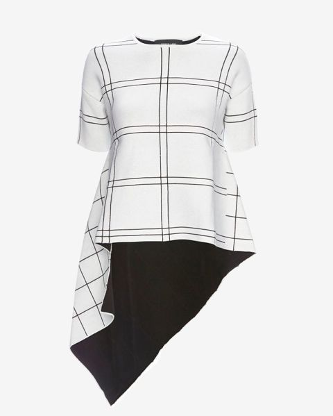 A dramatic tulle cape or off-the-shoulder top can really make an outfit—just add jeans and go. Shop the 19 best, including this Derek Lam Grid Pattern Asymmetric Top.