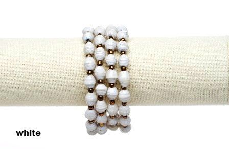 Ssanyu bracelet - white.  This wrap around bracelet was named Ssanyu,by the women, meaning Joy. It is also a name given to women. Hand rolled paper beads strung on metal cording, wrap happily around your wrist two or three times. No need for a fastener.