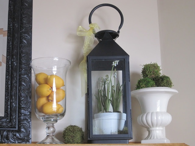 Decorating with lanterns. I love the look of this displaying a pot of fowers for Spring.