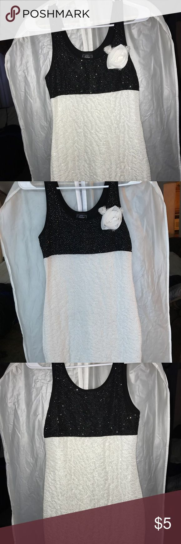 Black and white sparkly dress Actual size not known because the tag is worn. I am a size 6 and this is a snug fit and short lol, also as u can see u can see my undies through the back so nude undies :) or maybe white...not purple like me Dresses