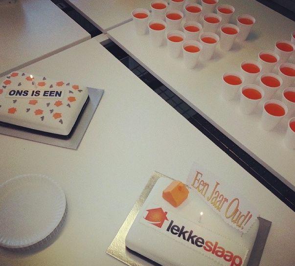 The TravelGround and LekkeSlaap teams celebrate LekkeSlaap's first birthday! Cake, Fanta orange, and free LekkeSlaap bags for all! Happy Birthday LekkeSlaap :)