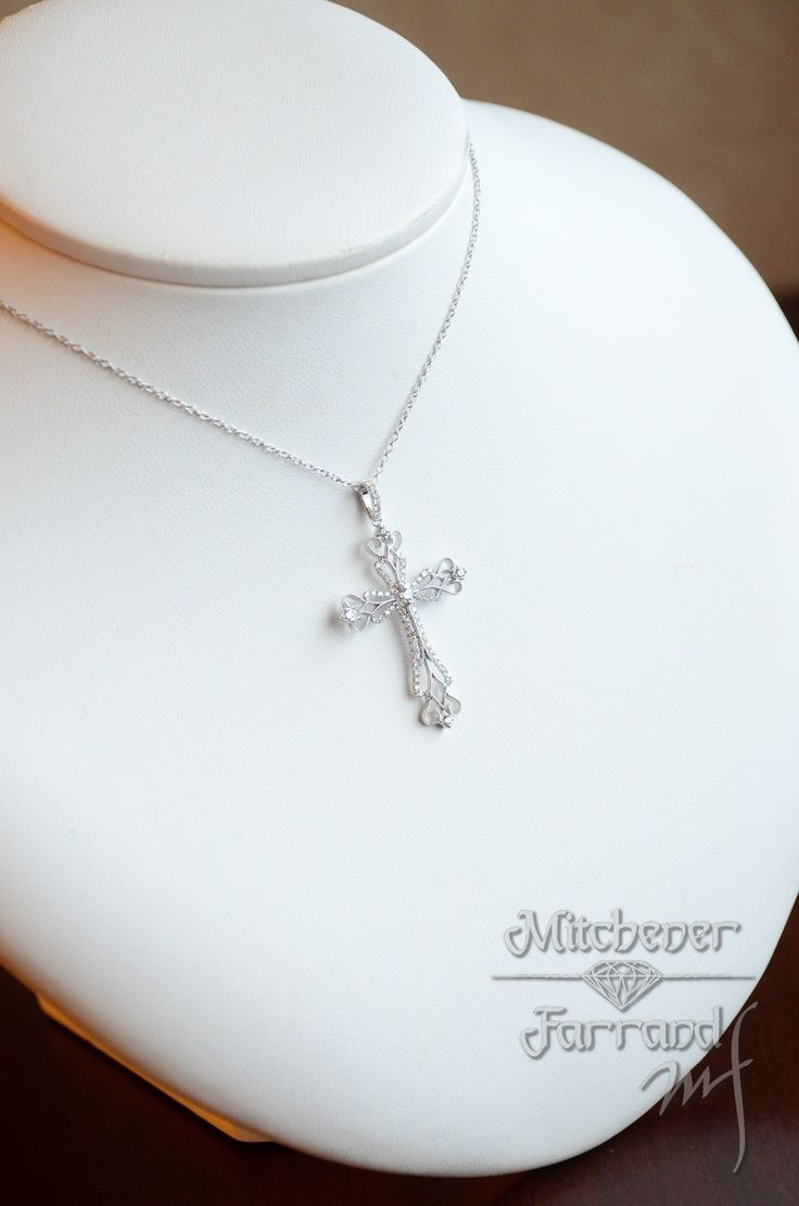 The intricate design of this 14 karat white gold and diamond cross necklace is beautiful without being too flashy. #mitchenerfarrand #gabrielny