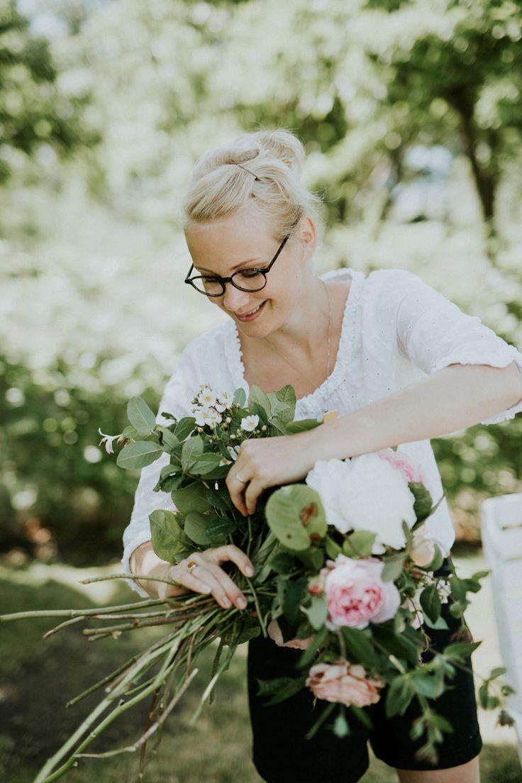 Mira making a garden bouquet. Elopement and destination wedding planner on the romantic island of Aeroe, Denmark. Danish Island Weddings - www.getmarriedindenmark.com