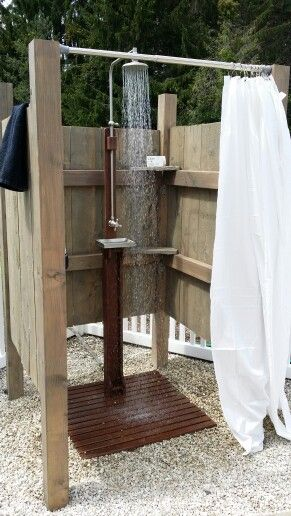 Poolside outdoor rustic shower. I purchased the shower online. It simply hooks to the hose. My husband built the enclosure. We wanted the rustic look so he did not fuss with the design. I need to add weights to the bottom of the curtain as it tends to blow into the shower. I think we will add a door next summer.