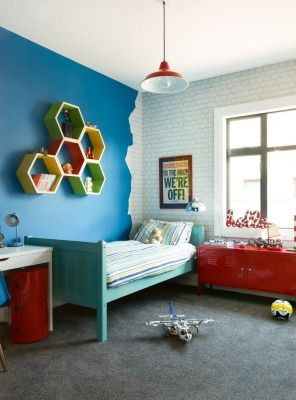 FINALIST BEDROOM, LOWER HUTT: Designer Debbie Omond, of Compose Interiors in Lower Hutt, was happy to see that her son Dylan has inherited her creative spark; the seven year old chose the vibrant blue paint, Resene 'Captain Cook' for the walls in his bedroom, a finalist in the Interior of the Year awards. With plenty of storage and display space this is a room that can see Dylan into his teenage years.