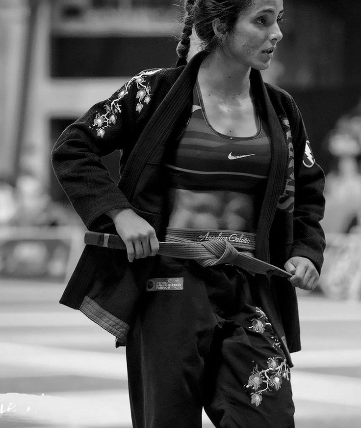 Angelica Galvao is a BJJ black belt with abs of steel.