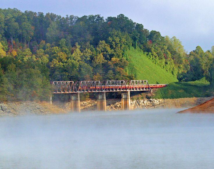 Take a scenic train ride on the Great Smoky Mountains Scenic Railroad along Fontana Lake in North Carolina