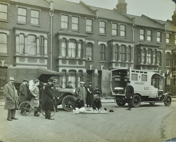 Road accident Calabria road Islington London 1925 A London County Council ambulance attending a road accident victim A crowd gathers round the site...
