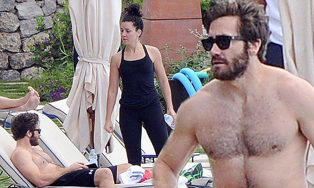 Shirtless Jake Gyllenhaal on Italian holiday with friend Greta Caruso
