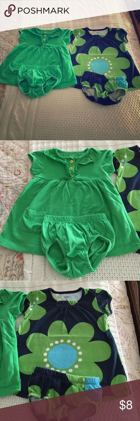 Carter's Baby Girl Dress Bundle Grass green polo style dress with ruffled neckline, short sleeves, front pockets, and light green flower shaped buttons. Comes with matching underpants. The second dress is navy with green and white floral pattern in a swing style. Comes with matching underpants. 100% cotton both 6 months from Carter's. Pre loved but good condition. Adorable and preppy! Carter's Dresses Casual