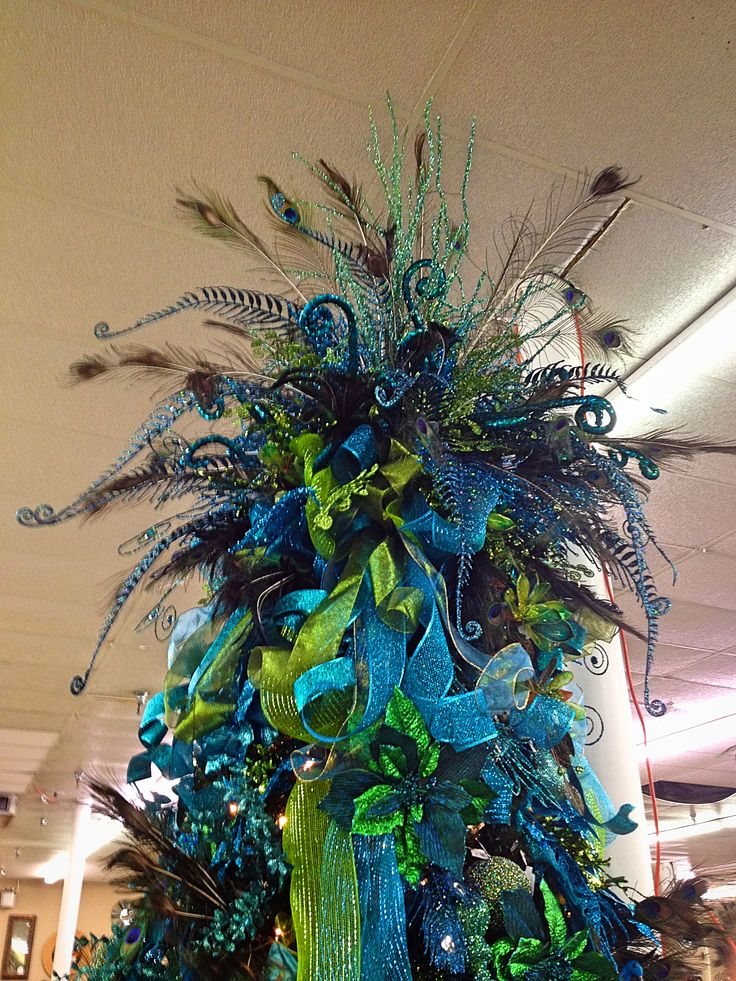 Peacock Christmas tree topper. My mom needs this for one of her trees.