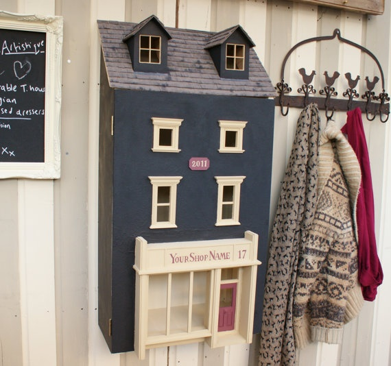 Upcycled Victorian Dollhouse into Storage Cabinet.
