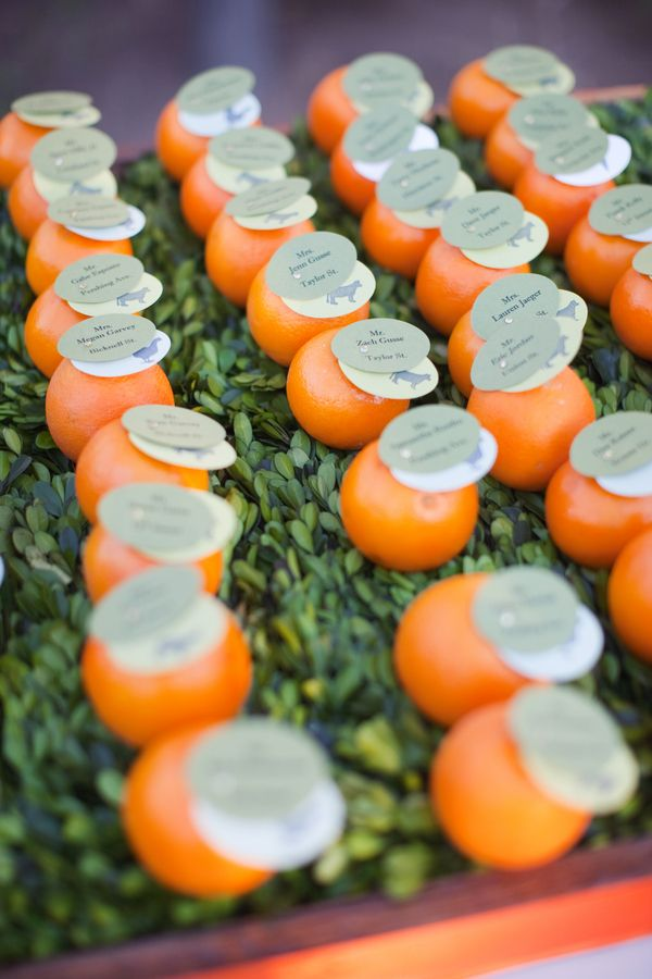Orange Tangerine Wedding Escort Cards. If we do glass vases of citrus fruits instead of flowers, this would go with that theme too...