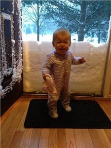LOL... poor kid! RT @jeremy_boston someone doesn't like the snow totals! http://pbs.twimg.com/media/BCqmnk7CcAAKc1i.jpg (via @nsj)