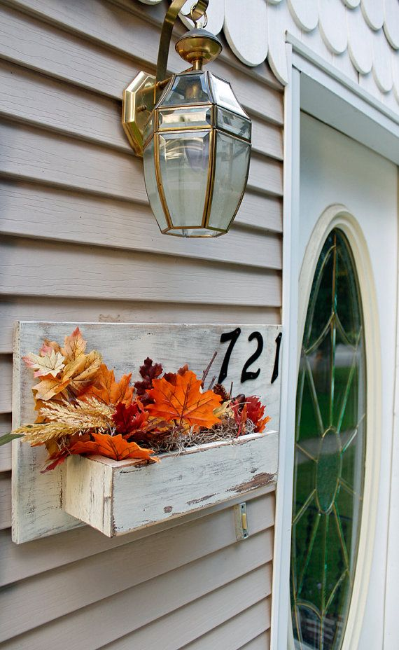 This rustic house number sign is built from solid reclaimed wood. It will not only boldly display your address numbers, but it also features a built