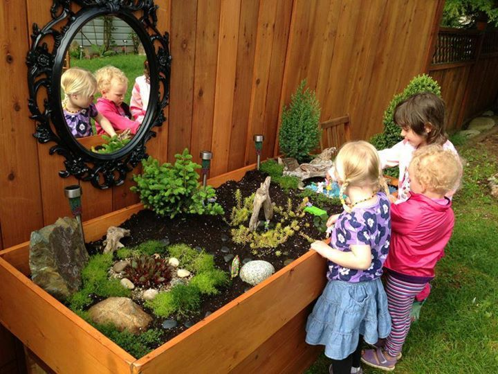 Raised bed/table miniature play garden. All kinds of creative fun! Also love the mirror! Bringing mirrors into the outdoor environment. - B