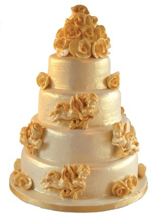 Belgian chocolate wedding cake with solid chocolate cherubs and handcrafted roses.