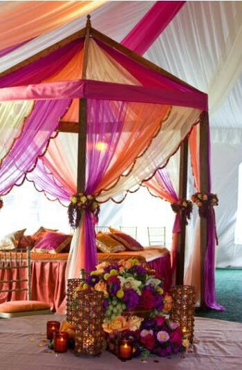 FAVORITE: Find the draping colors: Pink, purple, and orange to be a beautiful combination. I also like the tent look.