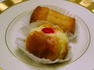 Rum Baba Sponge Cakes Soaked In Rum Flavoring And Filled With Vanilla Creme