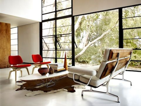 Featured in photo Eames Sofa; Eames Wire Base Elliptical Table; Eames  Molded Plywood