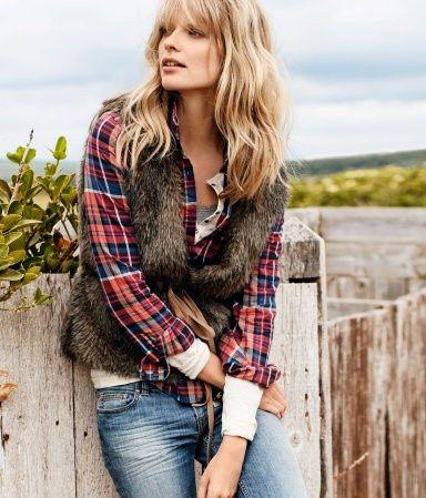 fur vest and plaid