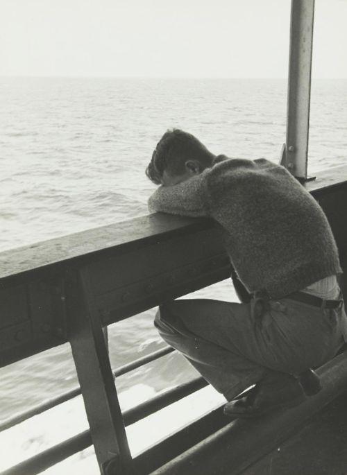 Vintage photo, man on boat.