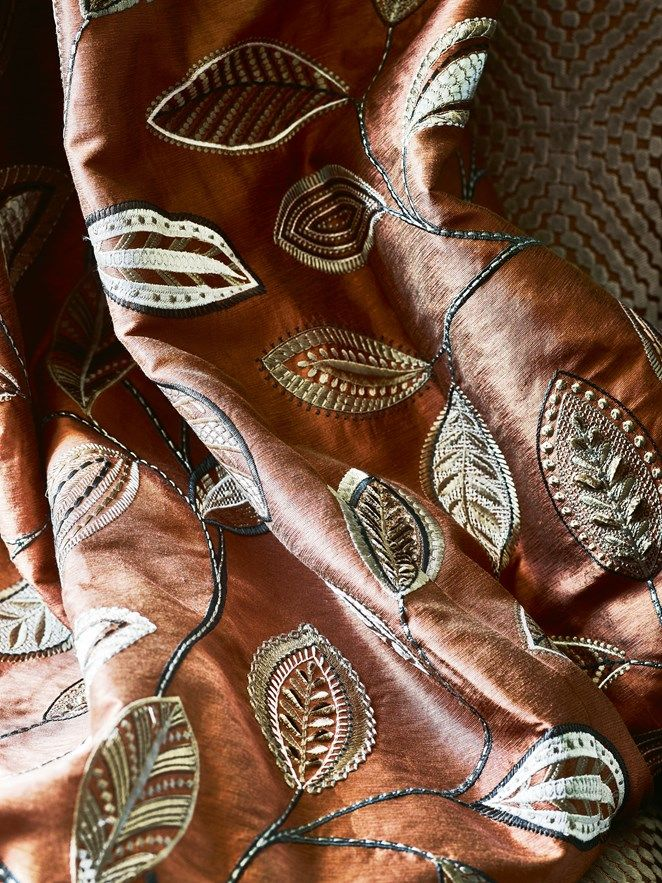 An opulent decorative leaf embroidery featuring an array of small patterns and stitchwork | Anza by Jane Churchill | Jane Clayton