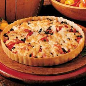Basil Tomato Tart Recipe -I received this recipe from a good friend of mine. It is a great way to us up fresh tomatoes from the garden. It reminds me a lot of pizza.—Connie Stumpf, North Myrtle Beach, South Carolina
