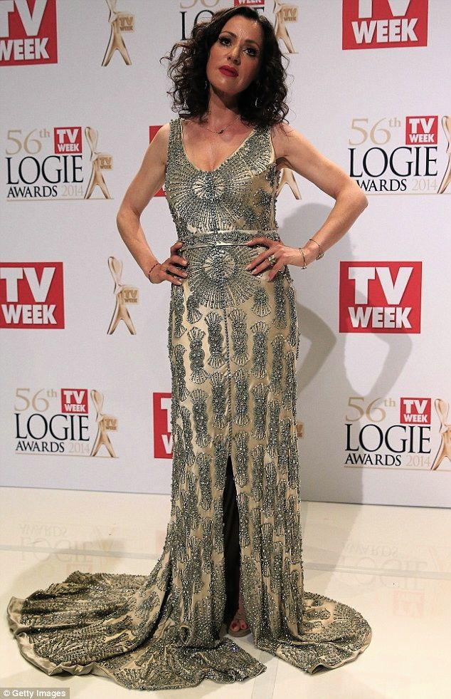 Gorgeous Tina Arena working her performance dress at The Tv Week Logie Awards 2014