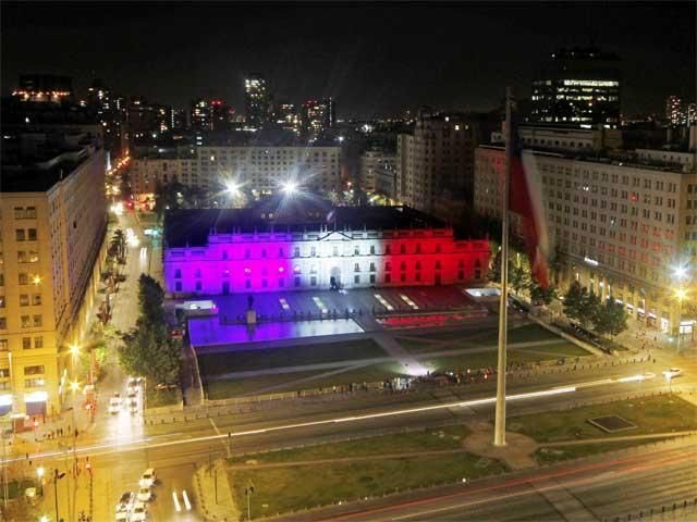 Day in pics : La Moneda palace in French flag colors - November 16, 2015 - The Economic Times