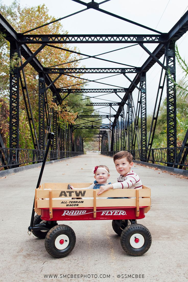 Fall family photo ideas with a wagon, family photo with siblings pic. - Steele Canyon Bridge, Rancho San Diego Fall Family Portrait Session