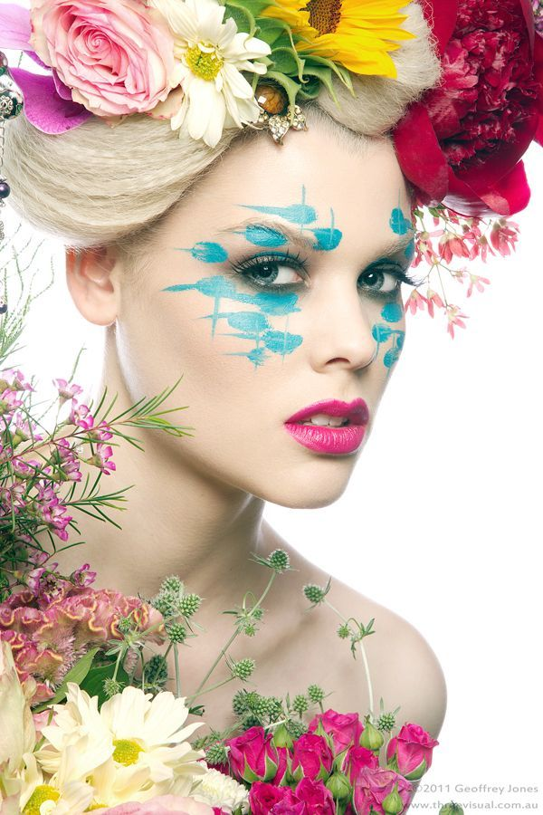 Her makeup looks like it was applied by smacking flowers into her face.