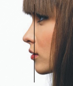 In an ideal profile, a vertical line can be drawn from the forehead to the farthest point of chin projection. If your chin falls short, consider a silicone chin implant.