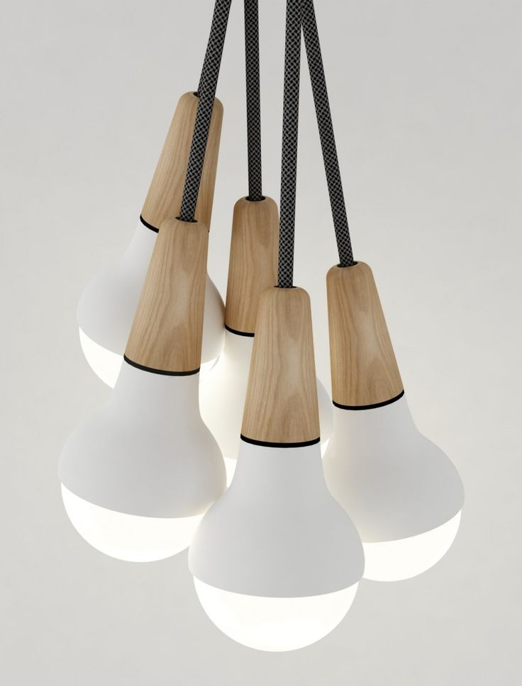 Australian designer Stephanie Ng has created Scoop, a pendant light made from wood and metal that was inspired by the shape of an ice cream cone.