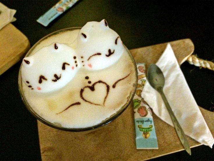 Lovely kitties in cup