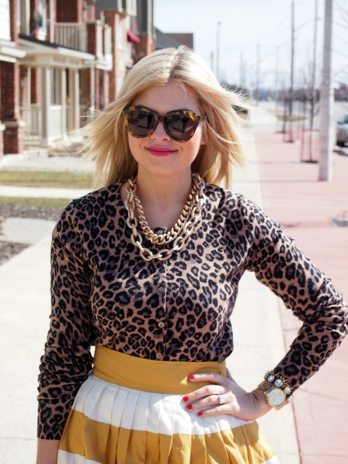 Leopard cardigan with mustard and yellow striped skirt.