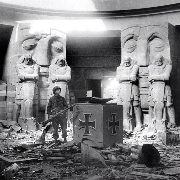 """The coolest looking room in Europe?! Site of another failed """"last stand"""" by the SS. In this photo from yesterday in WW2 history 4/18/45 a US soldier stands in the middle of the rubble in the Monument of the Battle of the Nations in Leipzig, Germany. The room commemorates the defeat of Napoleon in 1813. One of the last SS strongholds in the city, 150 SS fanatics stored three months of food and ammo in the monument and dug in. Then along came the American 1st Army and blasted them into…"""