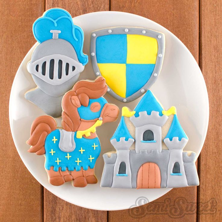 Knight themed cookies by Semi Sweet Designs | Step-by-step tutorial on how to recreate the castle cookie!