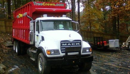 Grapple Truck For Sales - The truck also has a pup trailer.  The truck carries 47 cubic yards and the pup carries 30 + cy Truck has 53,411 miles I bought it new.   My entire business is for sale also
