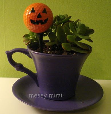 Awesome idea! Golf ball pumpkins!
