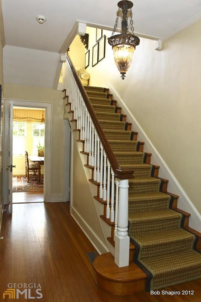 beautiful entry with antique light fixture sisal carpet on stairs and hardwood floors in the - Antique Light Fixtures