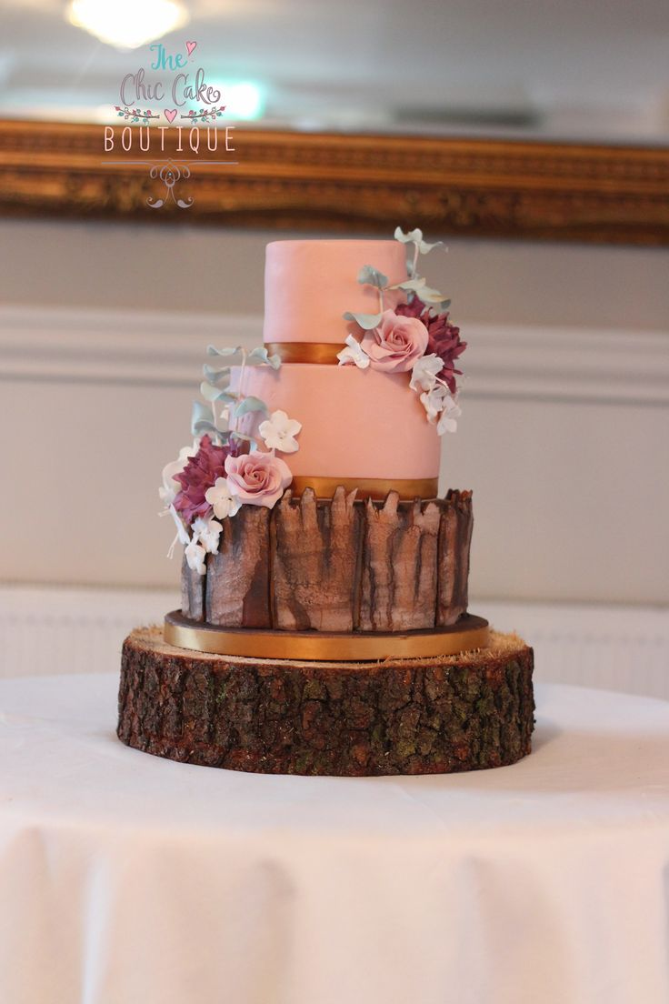 Hand made bark effect autumnal wedding cake with hand made sugar flowers