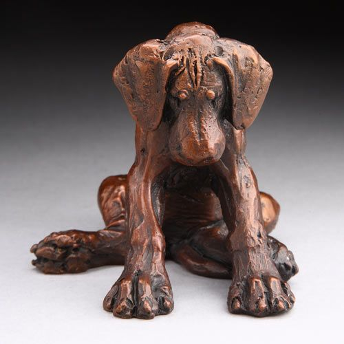 clay.  Don't have artist's name.  Looks exactly like a Great Dane pup with it's giant cartoon-like feet.