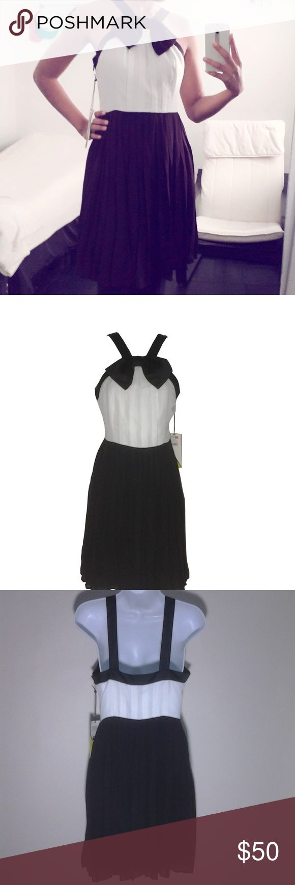 """Prabal Gurung Target Dress Black and white pleated skirt dress with pintucked bodice, satin trim and bow. Waist measures ~27"""" Bust measures ~34"""" Garment length ~35"""" 100% polyester Dry clean only. Prabal Gurung for Target Dresses"""