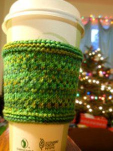 Give back to the environment with this cute knit cozy pattern. The Keep It Green Coffee Sleeve is a great way to get rid of extra scraps of yarn with a quick, easy knitting project.