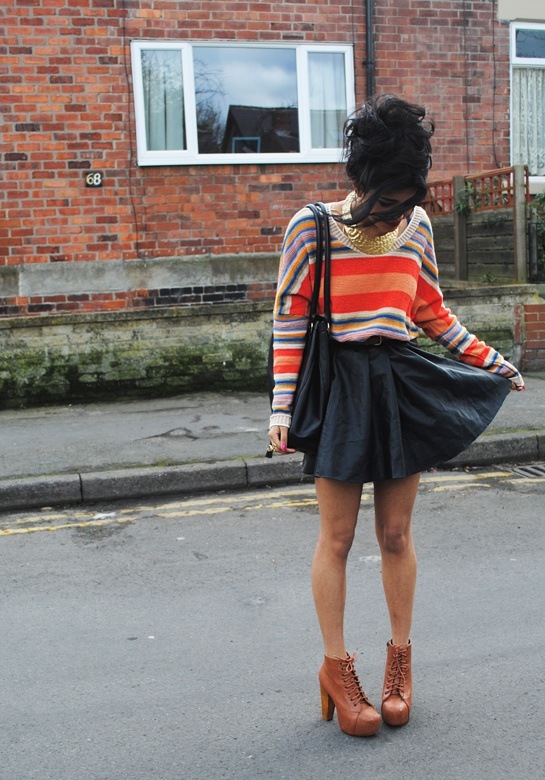 Rainbow knit jumper, c/o Apricot clothing  Faux leather skirt, H&M - £19.99  Gold collar necklace, Primark - £1 (sale)  Faux Jeffrey Campbell Litas, c/o soyoushoes  Black leather large handbag, charity shop - £5  Ring, Primark - £2